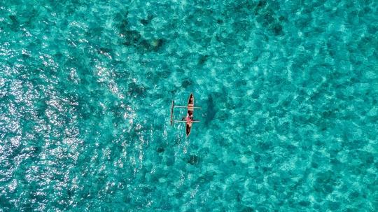 GLB 450 Pêcheur dans eau turquoise